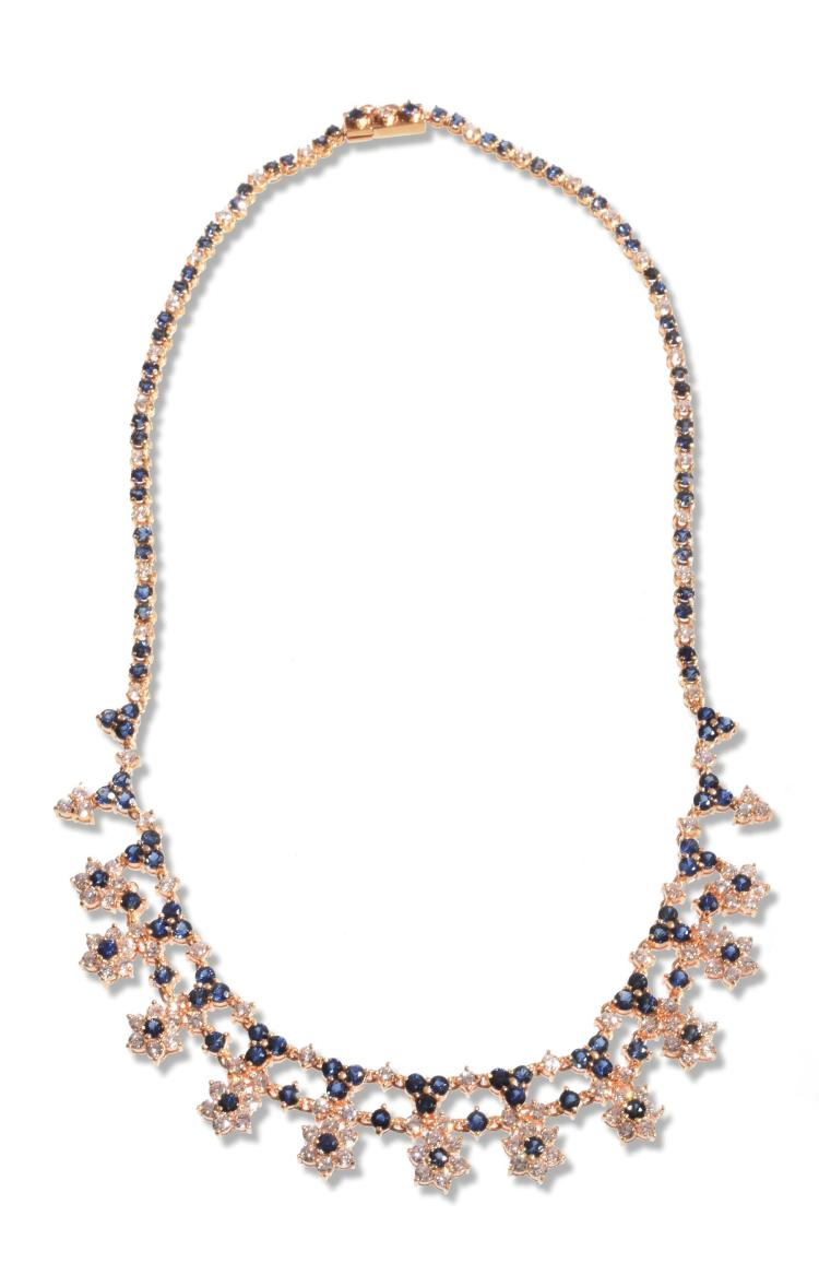 LADIES 18K DIAMOND AND SAPPHIRE NECKLACE.