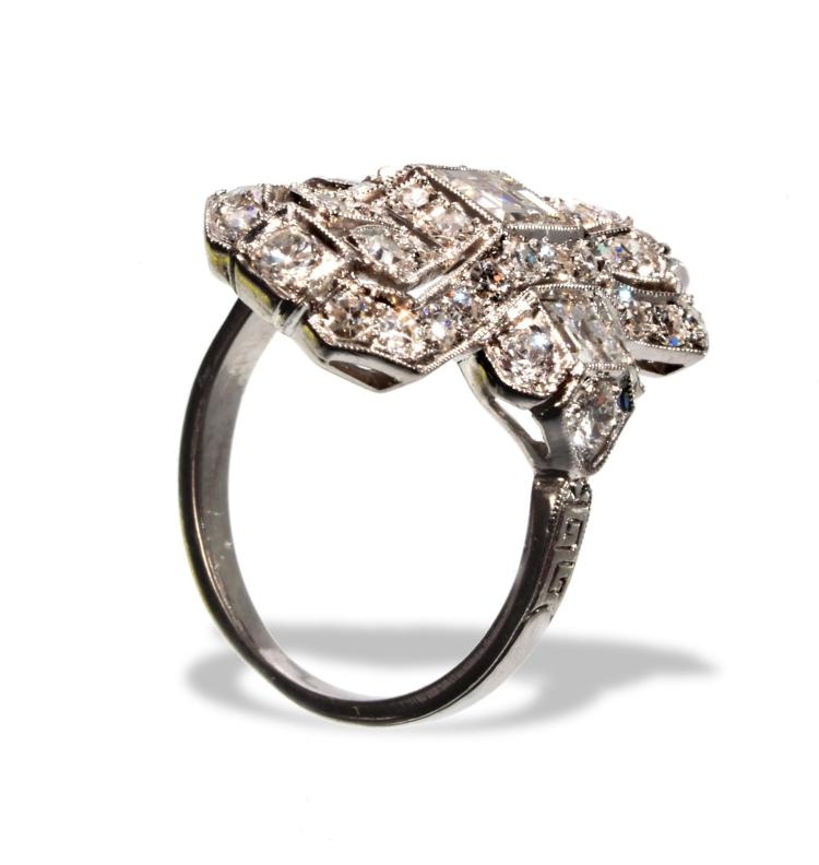 ART DECO PLATINUM AND DIAMOND RING.