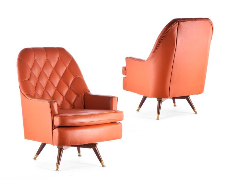 PAIR OF ORANGE BERKLINE LOUNGE CHAIRS.