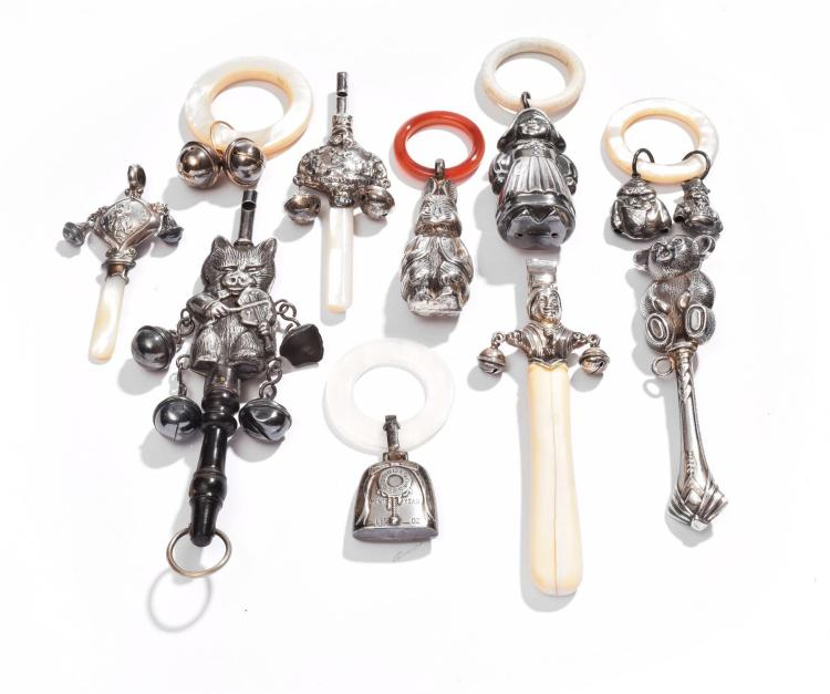 COLLECTION OF SILVER BABY RATTLES.