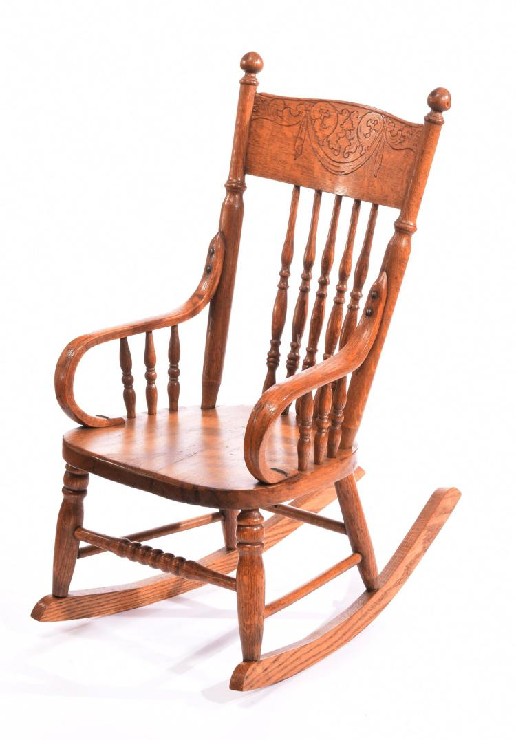 CHILD'S OAK ROCKING CHAIR.