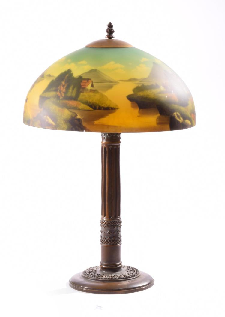 BRONZE TABLE LAMP WITH REVERSE PAINTED SHADE.