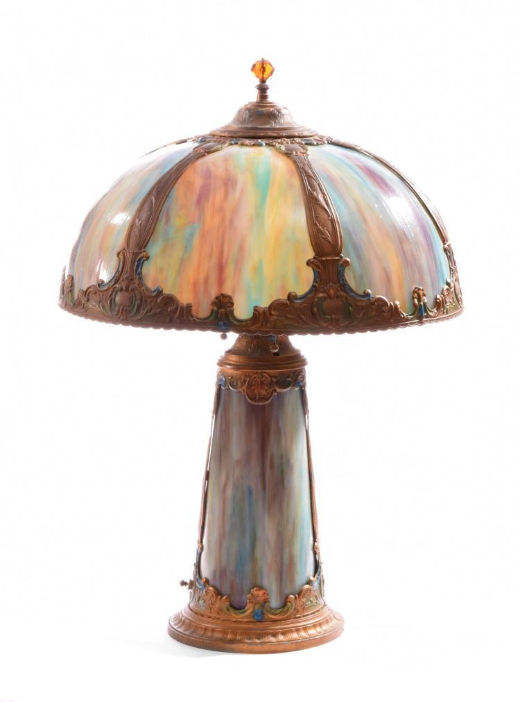 GILT METAL AND SLAG GLASS TABLE LAMP.