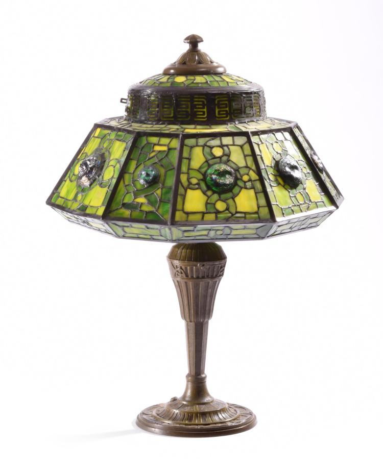 TABLE LAMP WITH UNIQUE GREEN LEADED SHADE.
