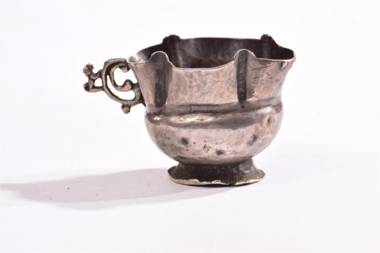 TRANSITIONAL PERIOD PRE COLUMBIAN SILVER MONKEY HANDLED DRUG CUP.