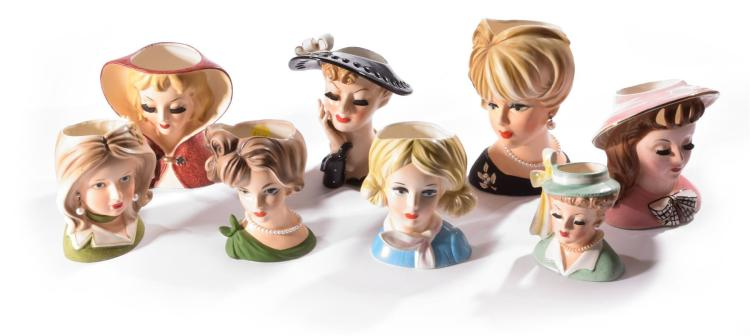 SET OF EIGHT NAPCO FEMALE HEAD PLANTERS.