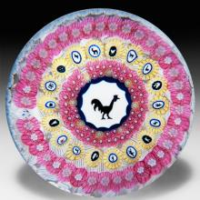 Baccarat 1971 Gridel rooster and concentric millefiori glass paperweight.