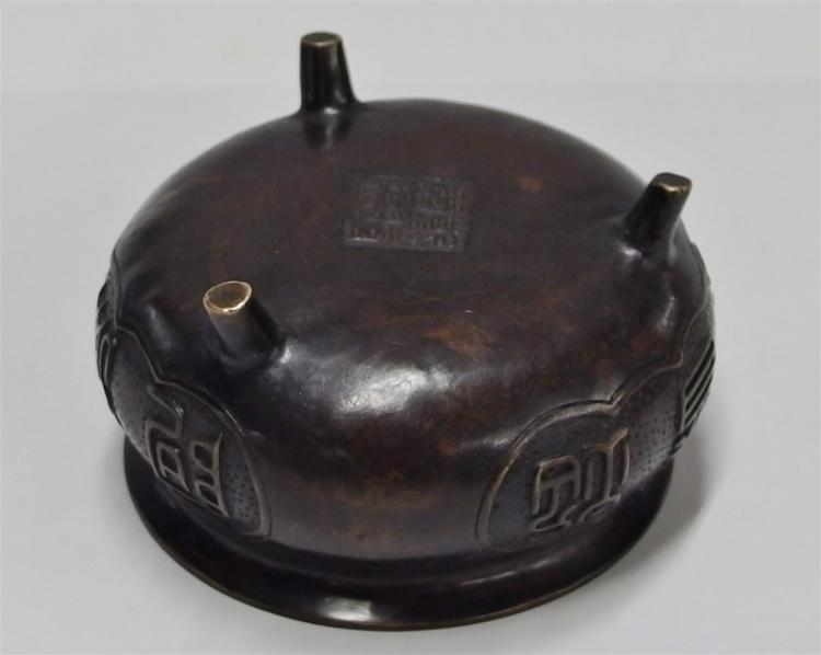 "Lot 77: Cast Bronze Censer with High Relief Characters, 5""D"