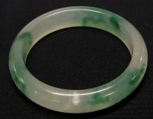 "Lot 87: Green & White Jade Bangle, 2-1/4"" interior diameter"