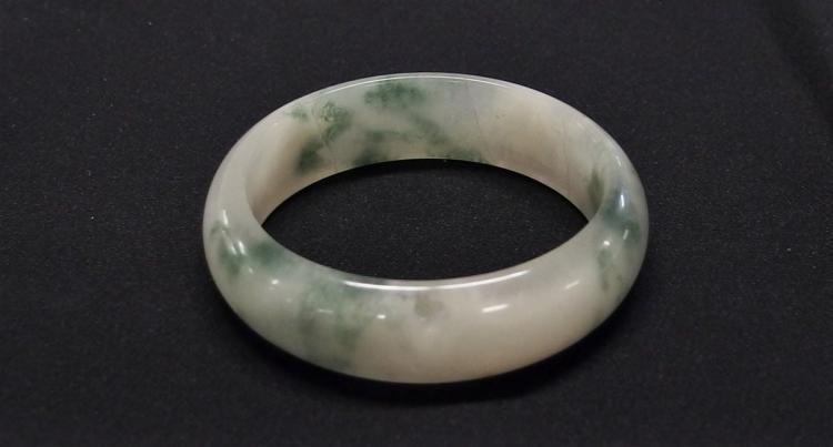 "Lot 104: Green & White Jade Bangle, 2-1/4"" interior diameter"