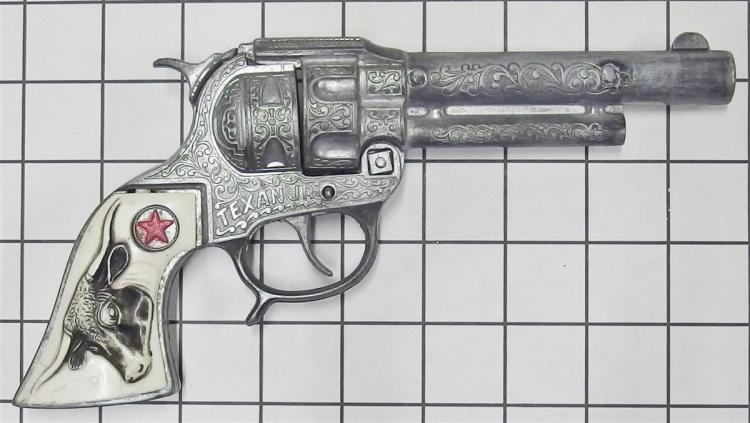 "Toy Cap Gun – Hubley TEXAN JR, Black & White Steer Head Grips, 9""L"