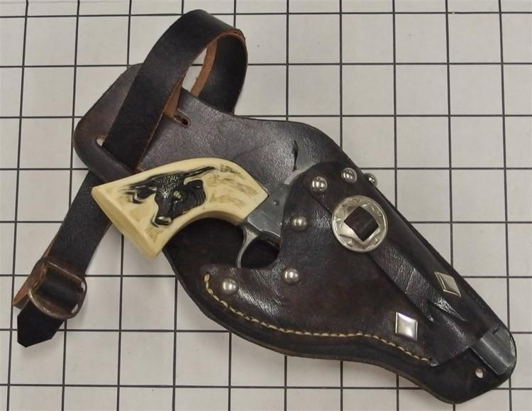 "Toy Cap Gun – DAISY, Steer Head Grip, 7""L, Black Leather Holster, 18"" Belt"