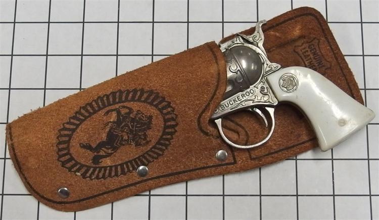 "Toy Cap Gun – BUCKEROO, Horse Head Medallion, White Grip, 8""L, Leather Holster"