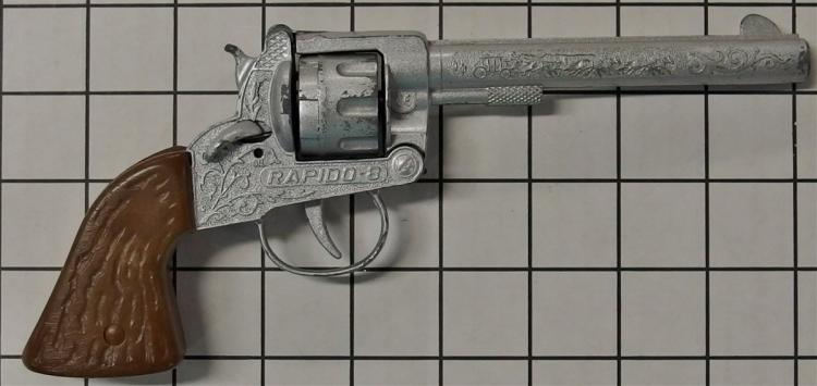 "Toy Cap Gun -  RAPIDO-8, 8-Shot Ring, Brown Stag Grip, Stagecoach Engraving, 9""L"