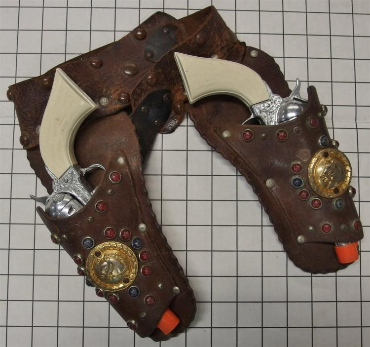 Toy Cap Guns - (2) PONY BOY Repeaters with Old Leather Double Holster with Horse Head Medallions