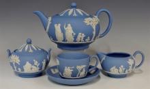 Lot 81: Wedgwood Blue Jasperware Teapot, Creamer, Sugar, Teacup & Saucer