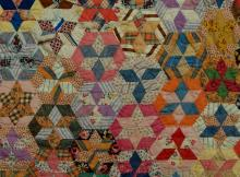 Lot 115: Antique Tumbling Blocks and Star Quilt with Applique Top Border 81x69