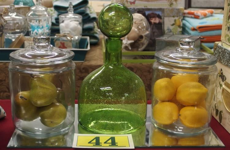 "Lot 44: Lot of 3 – Green Bubble Glass Decanter, 2 - 9"" Clear Canisters with Lemons & Pears"