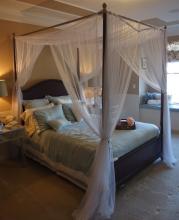 Lot 52: Queen Canopy Bed, Mahogany Finish 7'6 H x 6'5 W x 8'3L, Queen Mattress Set, New!