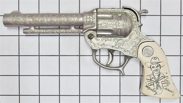 "Lot 5: 1950 Wyandotte HOPALONG CASSIDY Toy Cap Gun, Ivory White Incised Grips, 9""L"
