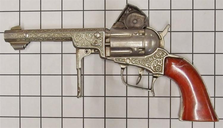 "Lot 12: 1950 Hubley PIONEER Repeater Toy Cap Gun, Orange Swirl Grips, 10""L"
