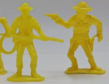 """Lot 29: 4 Toy Cowboy Figures, 3"""", Yellow"""