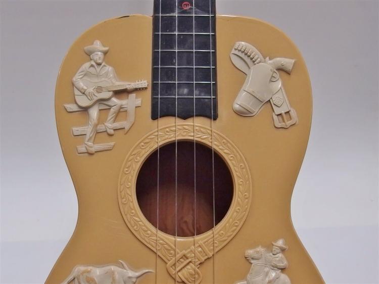 Lot 48: 1950's GENE AUTRY Emenee Plastic Cowboy Guitar, #601 Original Pick, 4-String