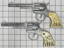 "Lot 68: 1964 Pair of DAISY NICHOLS-KUSAN Repeater Toy Cap Guns, 10""L, Dbl. Cowhide Holsters"