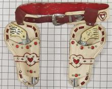 "Lot 69: 1964 Pair of Daisy NICHOLS-KUSAN Repeater Toy Cap Guns, 10""L, Hubley Cowgirl Holsters."
