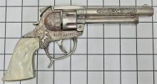"Lot 72: Leslie Henry GENE AUTRY Pistol 50 Shot Western Repeater Toy Cap Gun, White Horse Head Grip, 9""L"