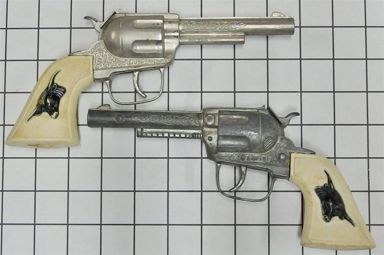 """Lot 73: 1966-70 Hubley GABRIEL Repeater Toy Cap Guns with Holster, Longhorns, 9""""L"""