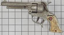 """Lot 74: 1940 Hubley TEXAN Cast Iron Repeater Toy Cap Gun, Steer Head Grips, 9""""L, Leather Holster"""