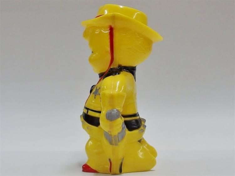 "Lot 106: Vintage Yellow Plastic Cowboy Sheriff Pitcher, 10""H"