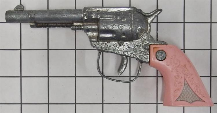 "Lot 140: 1970 Unmarked Hubley / Gabriel Repeater Toy Cap Gun, Pink Grip, 8""L"