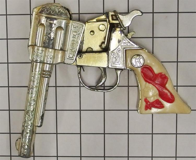 Lot 143: 1950's Kilgore RANGER Repeater Toy Cap Gun, Red/White Cowboy Bust Grips,