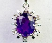 Lot 37: 14K White Gold Amethyst & White Topaz Pendant
