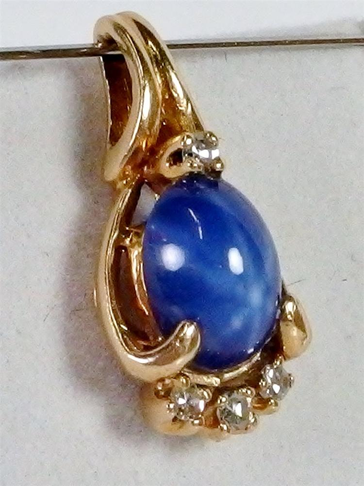 Lot 104: Star Sapphire and CZ Pendant