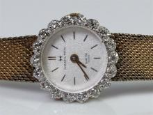 Lot 144: Hamilton Ladies Watch 10K RGP Bezel with 18 Diamonds