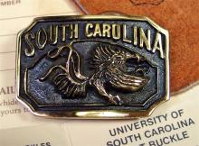 Lot 47: Lady's South Carolina Gamecocks Collectors Belt Buckle with Leather Pouch, COA