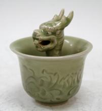 A Chinese Celadon Glazed Cup with Dragon
