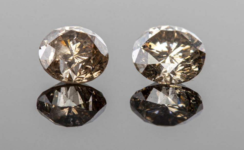 1.10 cttw. Pair of Loose Round Champagne Diamonds