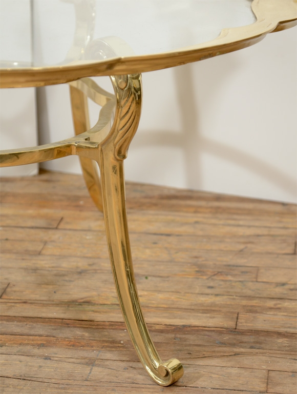 hollywood regency glass top coffee table on scroll base