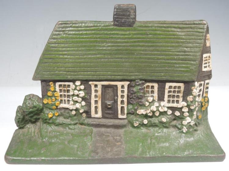 Vintage Painted Cast Iron Irish Cottage Doorstop