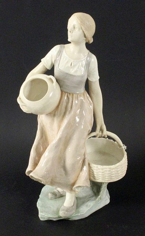 A DUTCH WOMAN WITH TANKARD AND BASKET