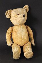 AN OLD TEDDY BEAR 1920s Movable head, glass eyes