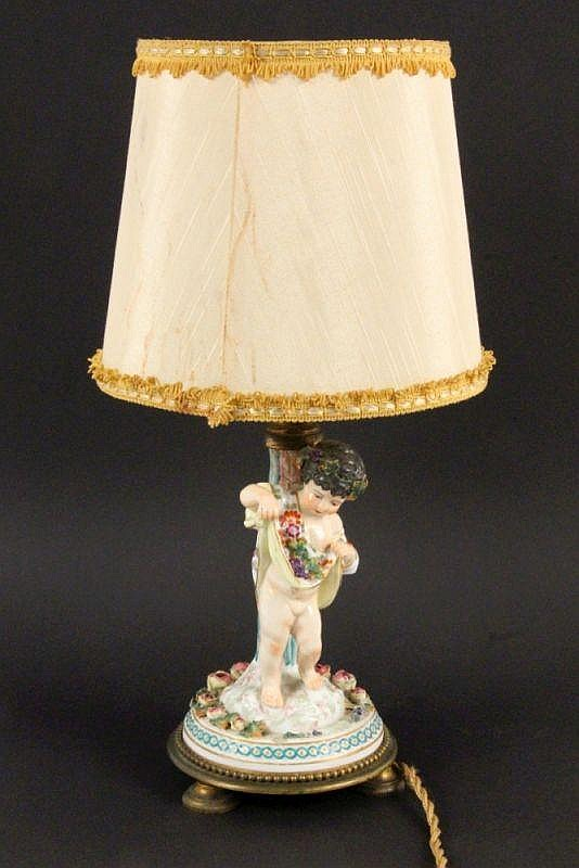 A TABLE LAMP WITH A PORCELAIN FIGURE France ca