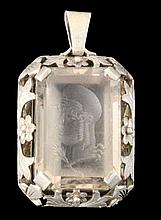 A GLASS ENGRAVED GEM with carved head of a god