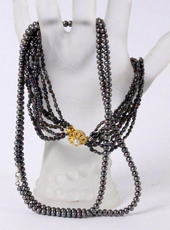 TWO GREY PEARL NECKLACES Cultured pearls of