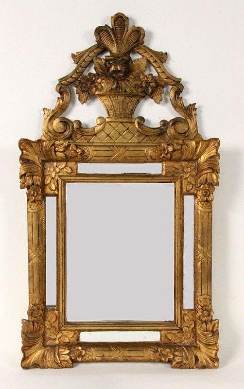 A WALL MIRROR IN EMPIRE SYILE
