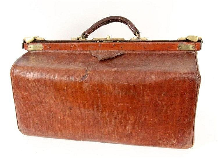 A MIDWIFE BAG ca. 1900 Leather with brass